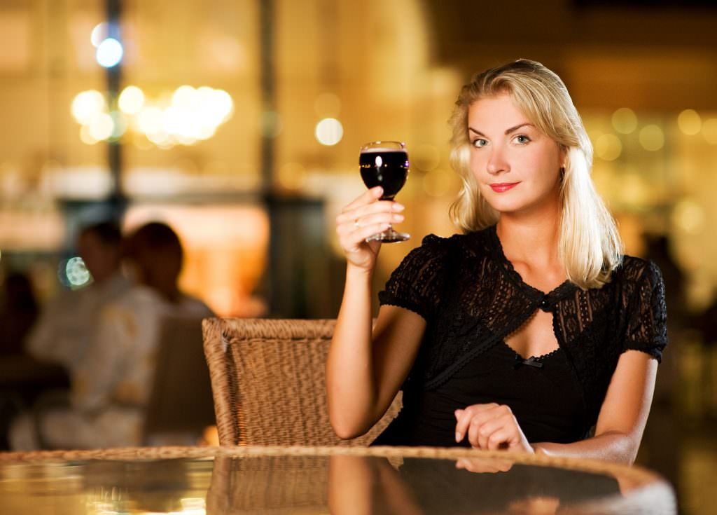 Woman holding up a glass of wine