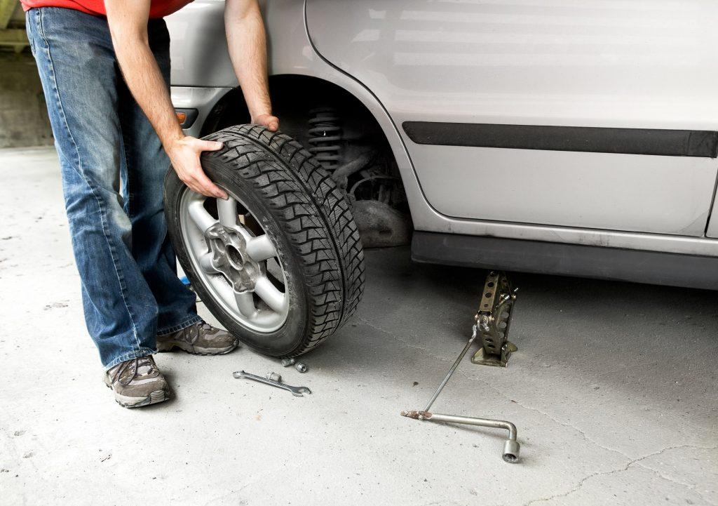 Man changing flat tyre