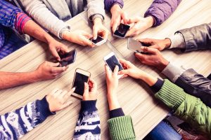 Top view hands circle using phone in cafe